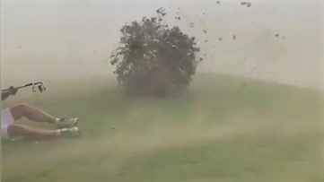Golfing is interrupted as crosswinds take over the course