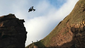 Watch This Daredevil Backflip Off a Cliff, Narrowly Avoiding the Rocks Below