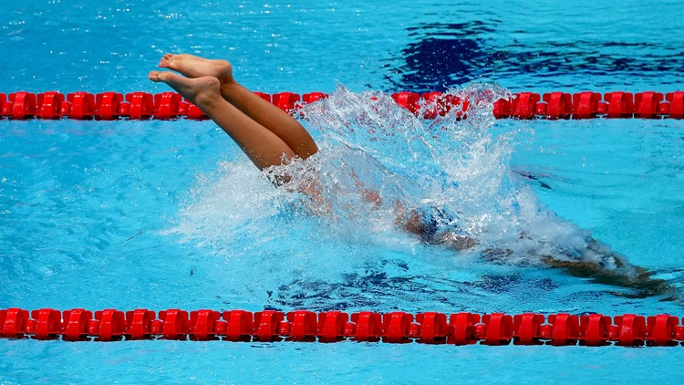 'When it comes it hits very hard' | Olympic swimmer hospitalized with COVID-19