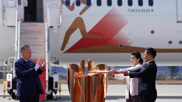 Olympic flame arrives in Japan as doubts grow over Tokyo Games
