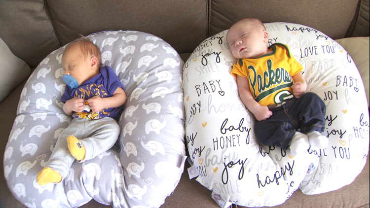 Jack Young dressed in Vikings purple and his cousin Cooper Young in Packers green and gold.