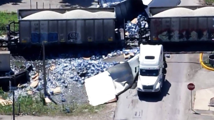 Thousands of bottles of water spilled after train collides with big rig in Richmond