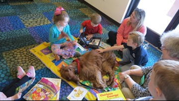Children practice reading at Dog Tales