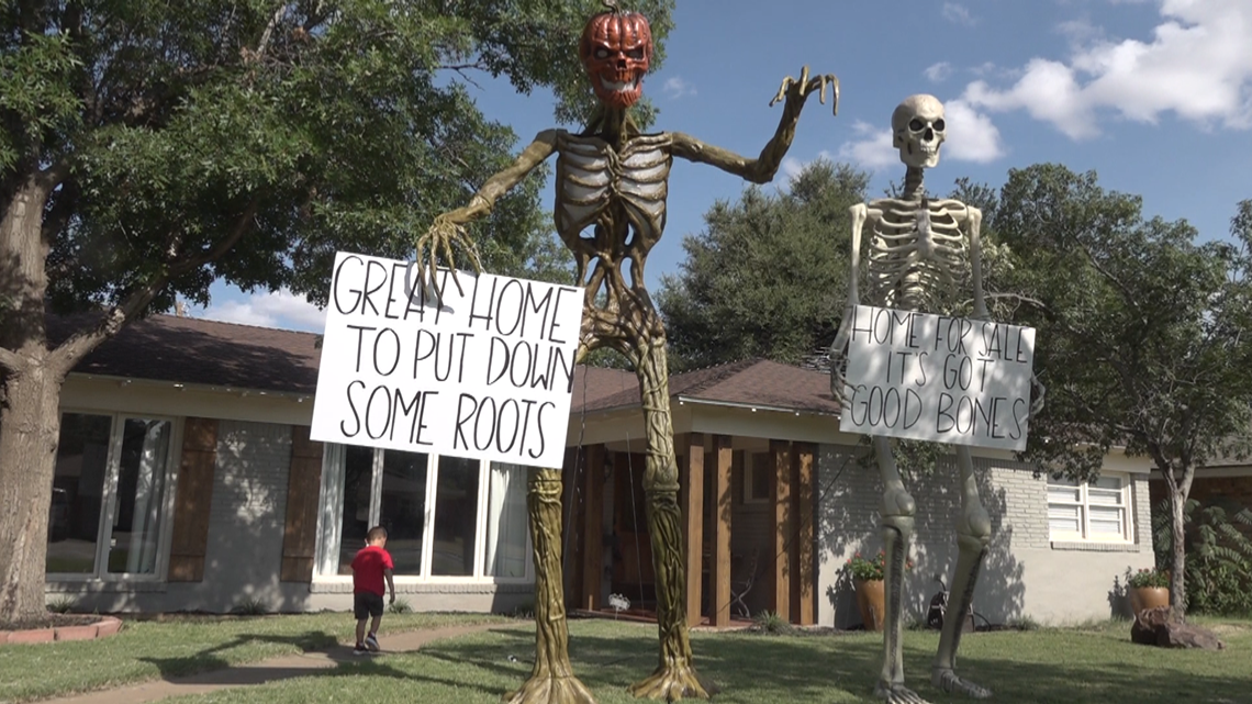 Midland Family has placed giant skeletons on their lawn to help sell their home
