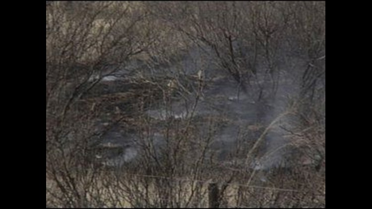 Firefighters Cleaning Up After a Grassfire Sparks Up