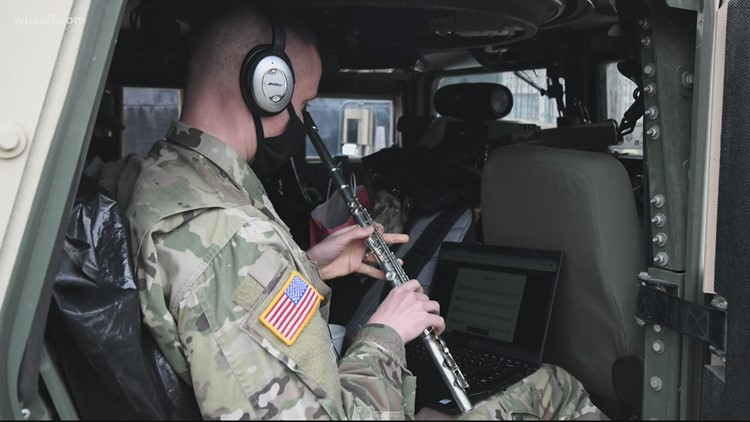 DC National Guard soldier teaching music at elementary school on Zoom while guarding Capitol